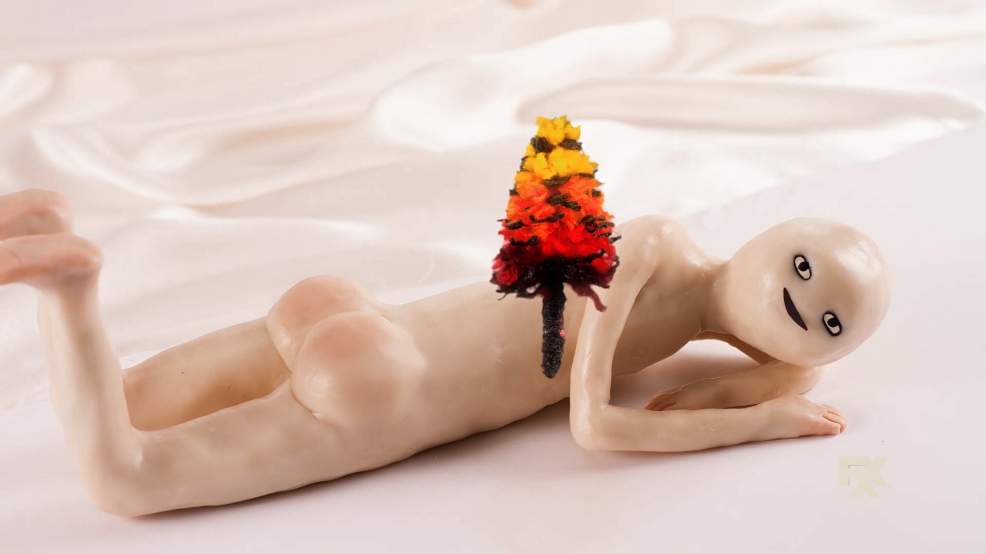 Viral video clip of naked humanoid with a bouquet of flowers