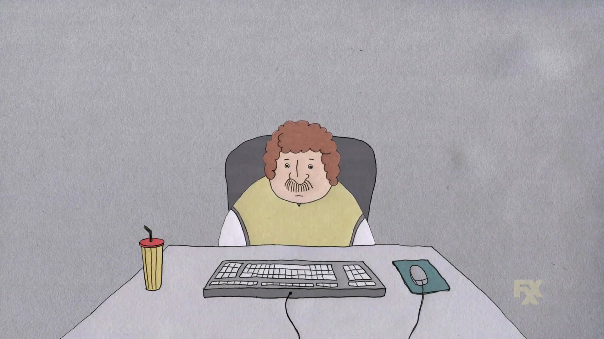 A somber man sits alone at a computer keyboard in a short animation from FXX's CAKE
