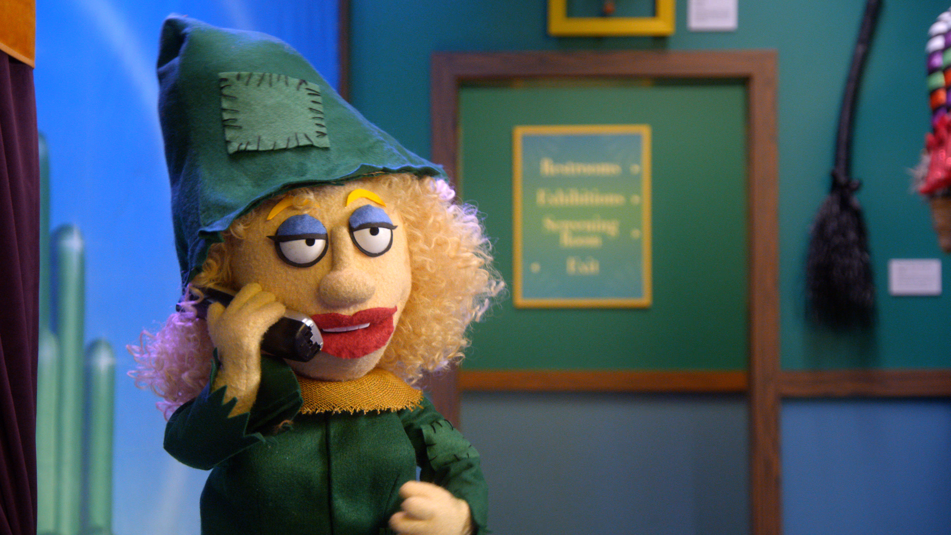 A female puppet dressed as a witch aswers a prank call from Thomas Lennon in a scene from Crank Yankers edited by Todd Bishop