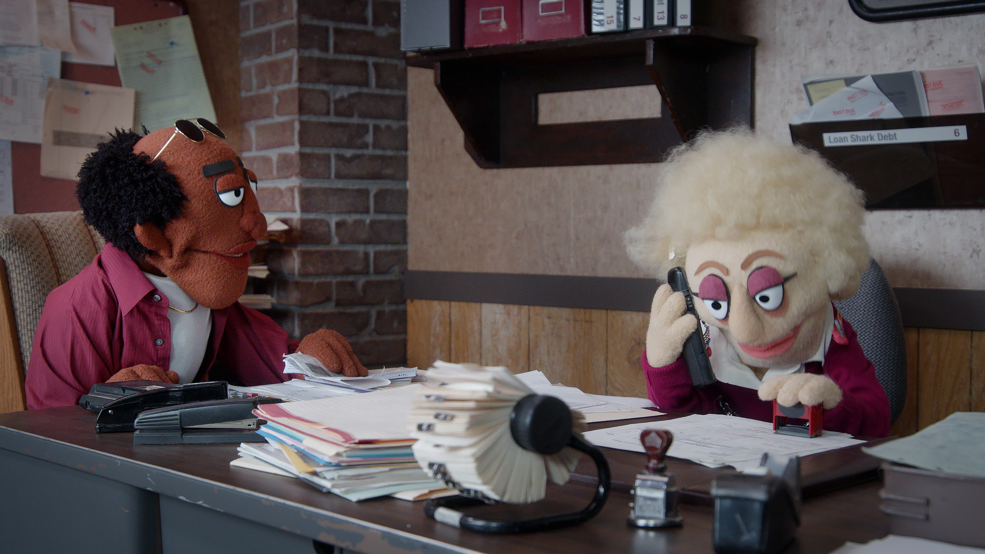 A female debt collector answers a prank call in a scene directed by Todd Bishop for Comedy Central's Crank Yankers