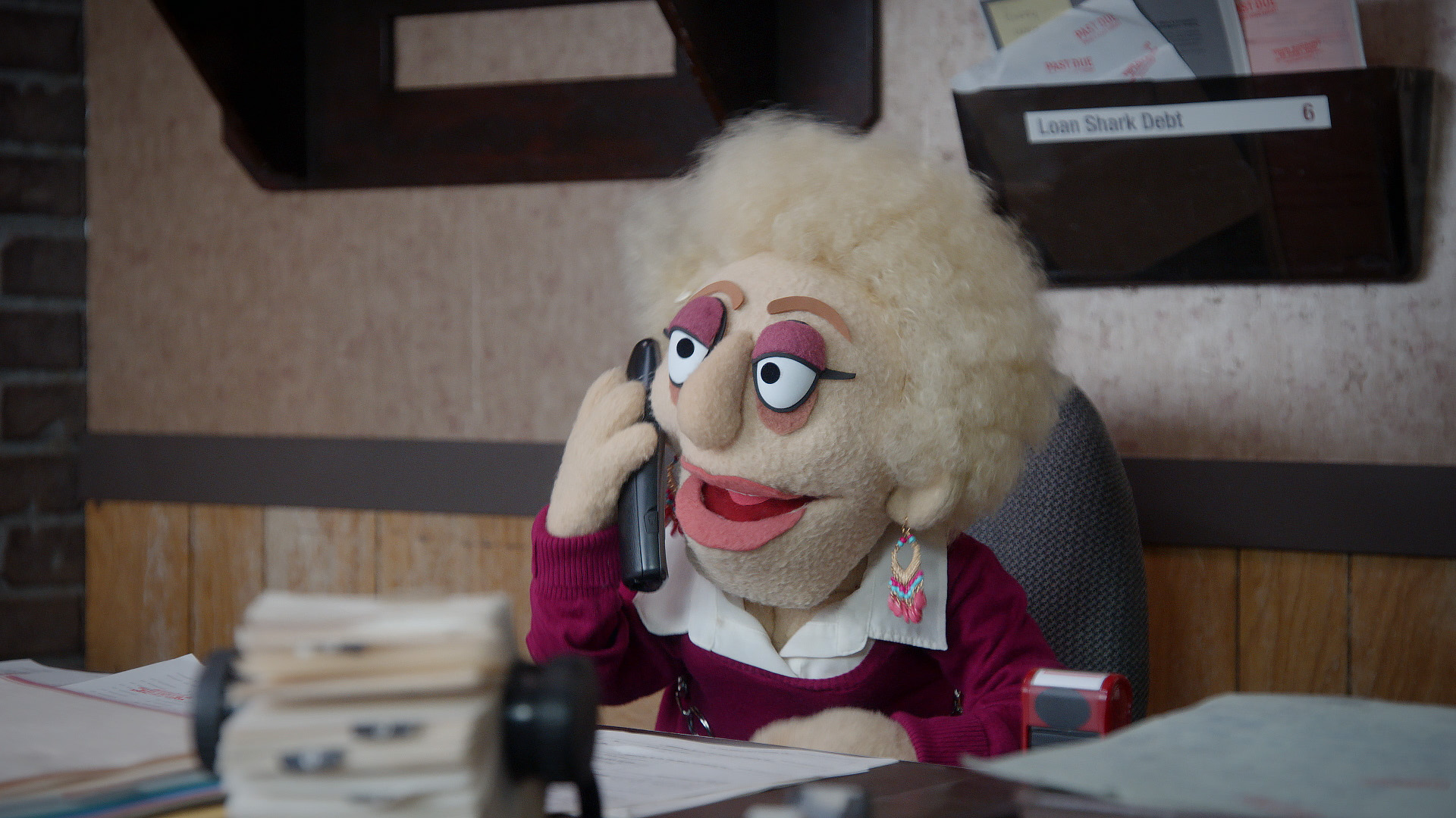 Female debt collector talks to Bobby Fletcher from a scene from Crank Yankers directed by Todd Bishop