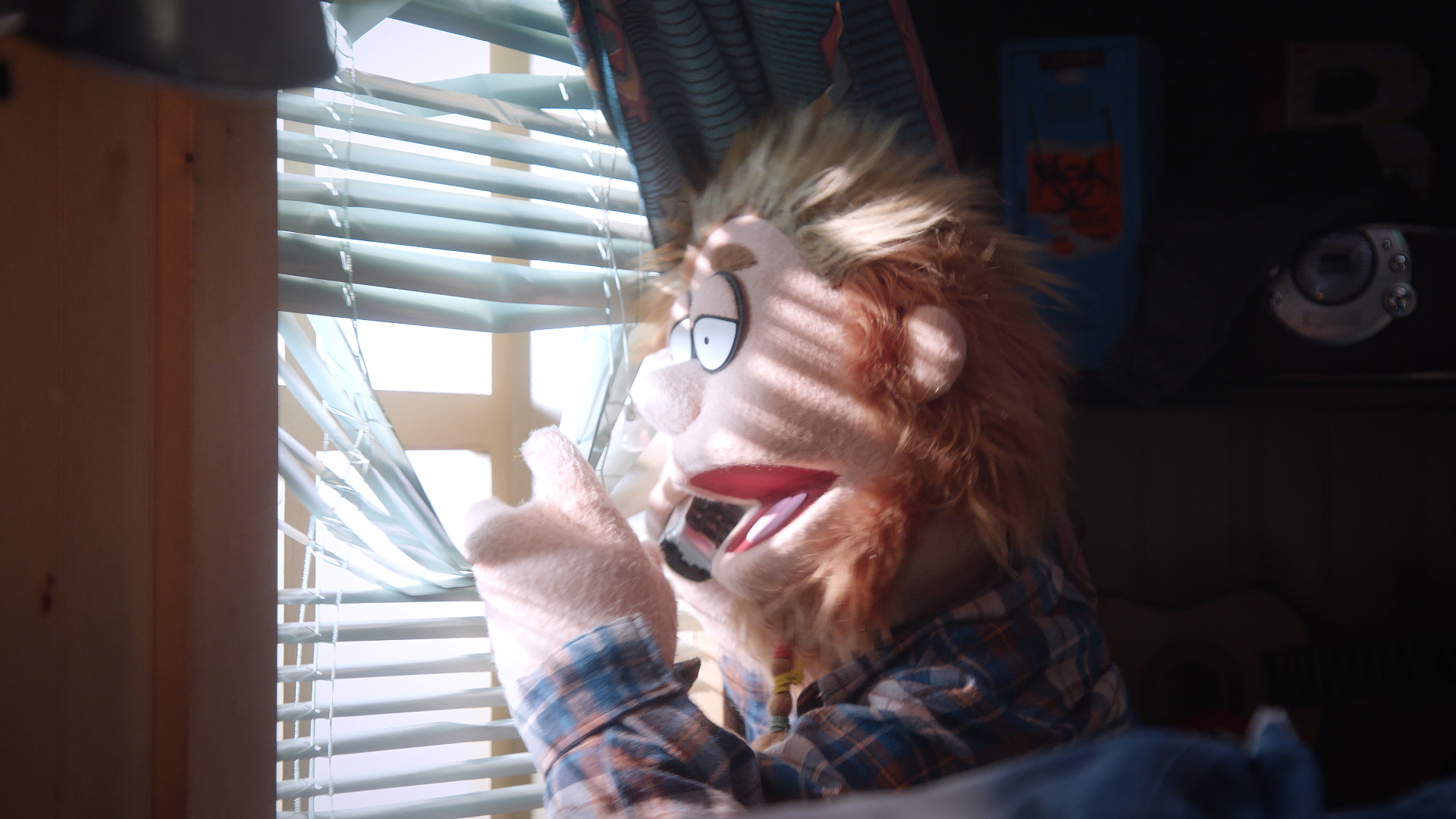 Bobby Fletcher looks out the window on Comedy Central's Crank Yankers in a call directed by Todd Bishop